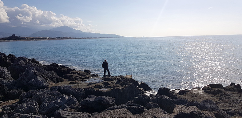 john on rocky beach at baia del carpino